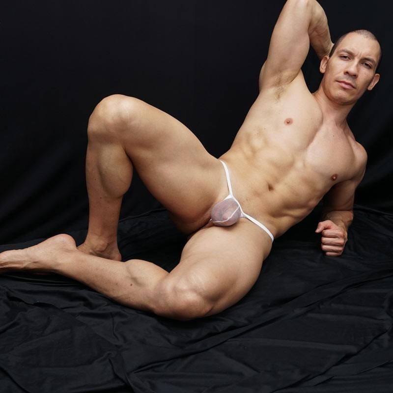 tanga hombre bulge hilo dental nylon 100% transparencia blanca vista acostado