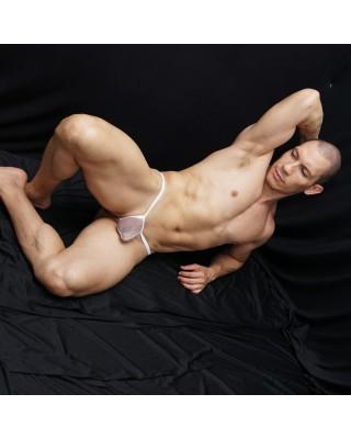 tanga hombre bulge hilo dental nylon 100% transparencia vista acostado
