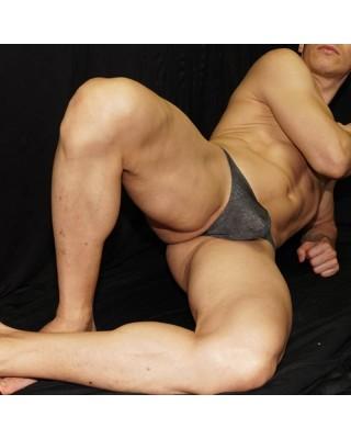 Tanga hombre microfibra gris melange, vista acostado de frente