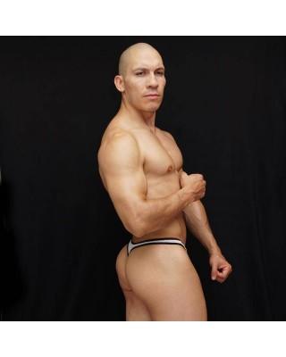 Tanga bulge hombre frente malla blanca con borde elastico de color negro.
