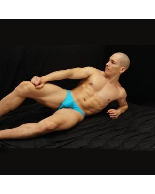 bikini hombre sin trasero color turquesa acostado de frente